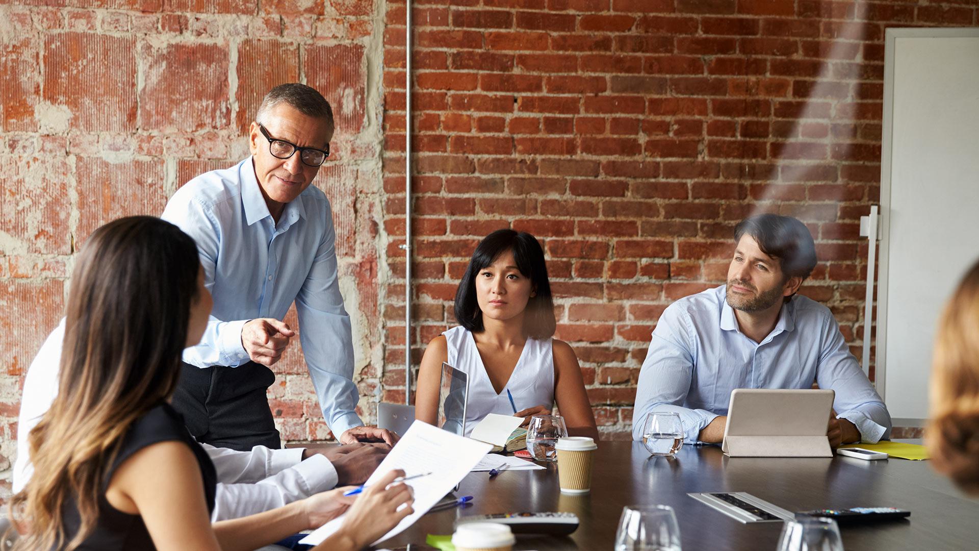 Tech People Meeting In Modern Boardroom